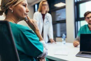 Nurse listening to understand in a meeting